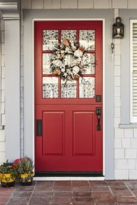 picture of red front door with curtains