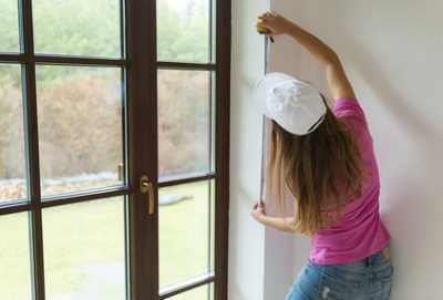 Woman Measuring Window Incorrectly
