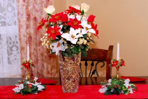 picture of red and white curtains and a dining room table decorated for christmas